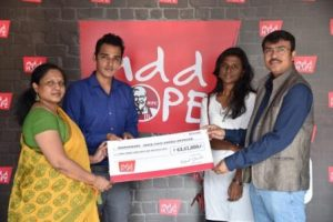 kfc-india-handing-over-the-cheque-to-representatives-fro