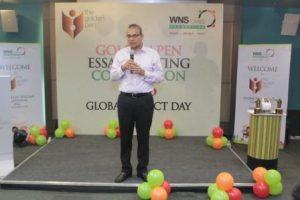keshav-r-murugesh-addressing-the-audience-on-global-impact-day